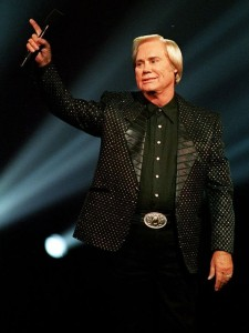 George Jones salutes the crowd at a 1993 event in Nashville. (Photo by the Associated Press' Mark Humphrey)