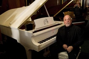The celebrated Piano Man will return to the Kennedy Center Honors after a nine-year absence. (Photo by the Associated Press' Charles Sykes.)