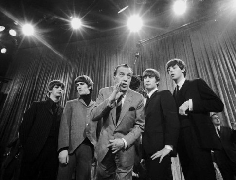 The Beatles pose with Ed Sullivan after an appearance on his show. (Photo property of the Associated Press)