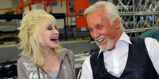 "Dolly shares a laugh with Kenny Rogers on backstage at the Grand at Foxwoods in 2010. (Photo property of ""The Huffington Post"""
