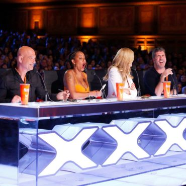 """The """"America's Got Talent: Season 11"""" judges (Howie Mandel, Mel B, Heidi Klum and Simon Cowell) share a laugh during a taping of """"AGT."""" (Photo property of NBC)"""