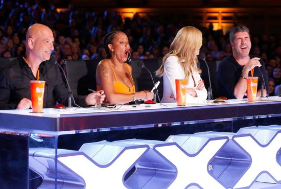 "The ""America's Got Talent: Season 11"" judges (Howie Mandel, Mel B, Heidi Klum and Simon Cowell) share a laugh during a taping of ""AGT."" (Photo property of NBC)"