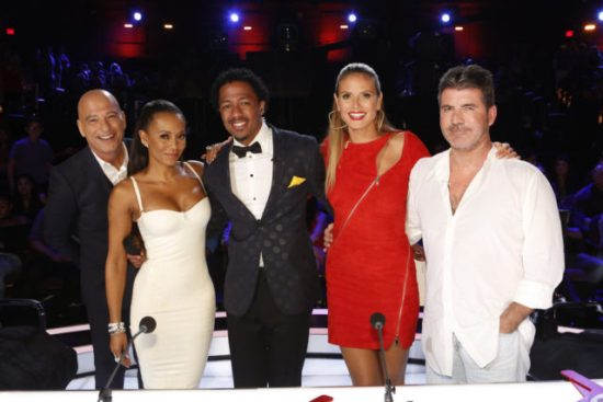 Nick Cannon and the judges pose for a photo! Which act received their second to last Judges' Save of the season? (Photo property of NBC's Trae Patton)
